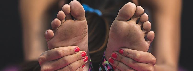 girl massaging feet
